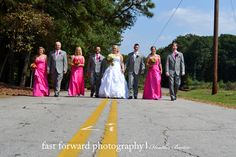 wedding photography, fun wedding party pose, pink bridesmaid dresses, outdoor wedding photography, groomsmen grey tux, #great wedding poses