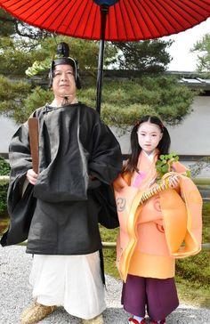 Proud Kyoto citizens Takashi Okada and granddaughter Mayu dressed for the Aoi Matsuri festival