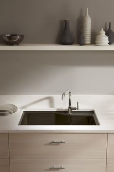 Purist faucet with 8-inch spout   Indio sink   The suede-color sink's the star of this pared-down yet glamorous work space.