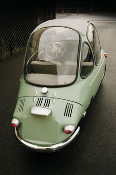 The tiny, egg-shaped #Heinkel Cabin Cruiser is a mere 8 feet long and 4 feet wide.  Entry is through the large single door that is also the front of the car!  #microcar