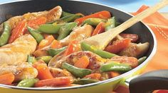 Orange marmalade lends sweet flavor to this skillet meal featuring chicken, carrots and sugar-snap peas.
