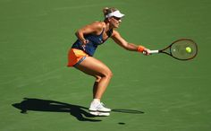 Angelique Kerber Photos Photos - Angelique Kerber of Germany plays a forehand against Pauline Parmentier of France in their third round match during day eight of the BNP Paribas Open at Indian Wells Tennis Garden on March 13, 2017 in Indian Wells, California. - BNP Paribas Open - Day 8 Celebrity Photos, Celebrity News, Indian Wells Tennis, Angelique Kerber, Bnp, Tennis Fashion, Opening Day, Tennis Racket, Plays