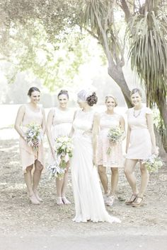 Bridesmaids in mismatched peach dresses