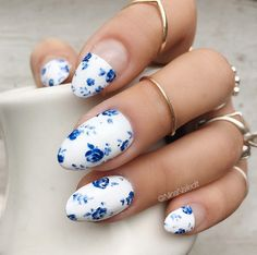 White nails with blue flowers by Nina Park