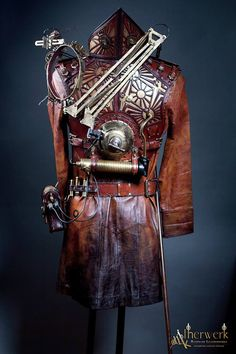 Mage of Time Steampunk Armor, 100% Handmade, Leather, old and antique gears, clockworks and brass pieces, smoke machine, flexible mechanical arm at the back with mechanical cap and lights. Around 23 Days working hours. Arm part and is still missing and leather coat isn´t finished.