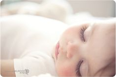 I love this photo primarily because of lavender eyelids & long, dark eyelashes! I've taken this shot with my own little ones! So beautiful!