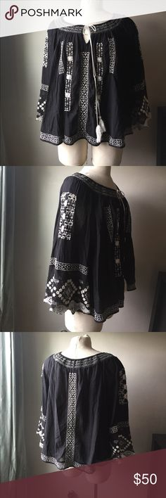 """Free People Boho Crochet Top with Tassels, EUC Black top with intricate white crochet detailing.  Top is in excellent used condition. It is lightly elasticized at collar and sports a tassel tie closure that can be adjusted.  Tassel ties can be tied multiple ways. 100% Cotton. Very soft and lightweight.  Perfect summer shirt. Crochet is open so skin or a tank will show underneath.  Bell style arms.  Back collar to hem 23"""" pit to pit 28"""" sleeve from collar to end 25""""  very roomy without being…"""