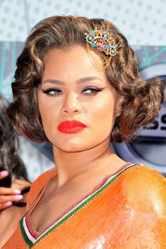 Singer Andra Day's short 'do is very old Hollywood glam, and we love it! Jazz up a short hairstyle with an ornate hair clip.