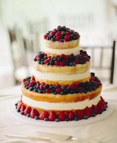 Berry-Topped Naked Cake | https://www.theknot.com/content/top-most-amazing-wedding-cakes-of-2013