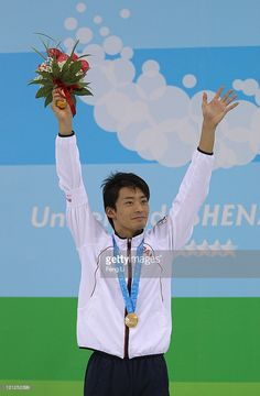 Ryosuke Irie of Japan celebrates winning the gold medal in Men's 50m Backstroke Final during Swimming Day Three of the 26th Summer Universiade at Universiade Center on August 16, 2011 in Shenzhen, China.