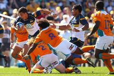 Matt Toomua of the Brumbies is tackled during the round three Super Rugby match between the Brumbies and the Cheetahs at Canberra Stadium on March 10, 2012 in Canberra, Australia.