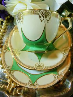 Aynsley tea cup and saucer trio art deco green star on cream lush ornate gilt