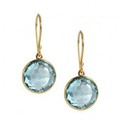 Blue topaz bezel set in gold.  A beautiful pop of refreshing color to wear with summer's whites, navies, and hot poppies.