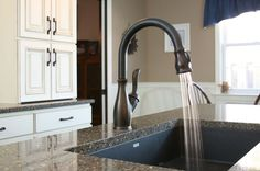 Single-bowl granite composite sink in a dark color. Its durability and requires minimal work to keep it looking clean. It can easily fit the largest pots and pans for soaking.  Undermount the sink for easier kitchen cleanup.