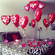 I decorated out bedroom for part of  my Husband's valentine gift. Each balloon had a paragraph about something I loved about him clothes pinned to it!! :)