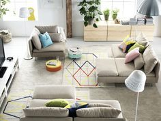 Despite it's IKEA, I really enjoy this living room! Sofas and how they are displayed, place for legs and/or dog, movable tiny tables, just perfect! Nice soft colors + geometrical cushions and carpets add some joy!