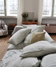 Piles of linen pillows.