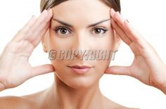 Close-up portrait of a beautiful and fresh woman stretching the face