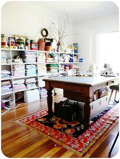 Sewing room. I like the idea of the table in the center of the room!  I can take my old farmhouse table,  raise it to a comfortable level and use it as a cutting table!