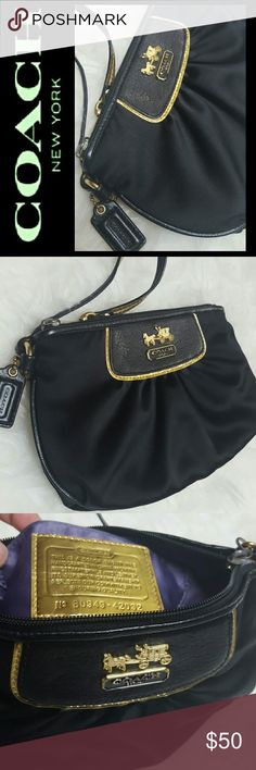Coach Black Satin Wristlet Coach Signature Wristlet in Gorgeous Black with Gold Tone Accent of Iconic Carriage! Handcrafted from the Finest Materials Trimmed with Leather!   Zipper Top Closure Opens to Fully Lined Interior with Slip Pocket, and Coach's Quality Plate Pledge! Approx Size 9x5.5 inches,  Used in Good Condition! Coach Bags Clutches & Wristlets