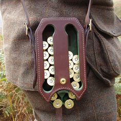 Sweet genteel shotgun shell dispenser!  I'm unable to find the source, nor find anything like it on Google...