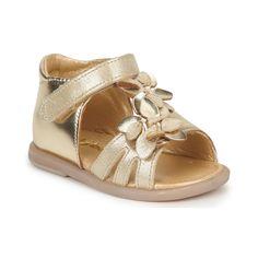 ¡Las pequeñas buenas merecen unas sandalia de cuero metalizado! Adornada con flores, no olvida el confort y eso gracias a una correa velcro que asegura una buena sujeción