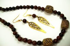 8mm mahagony obsidian and african brass trade beads on the 18