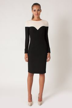 """Black Halo - Marla Sheath - Black Buttercream   An easy choice for work or play, the Marla Sheath debuts in our Double Face Viscose Blend. Dress features jewel neckline, alluring color-blocking detail and sleek fitting sleeves. Fully lined with center back hidden zipper. Dress falls 42"""" from shoulder."""