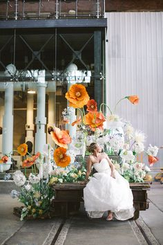 Installation of Enormous Orange and White Paper Flowers