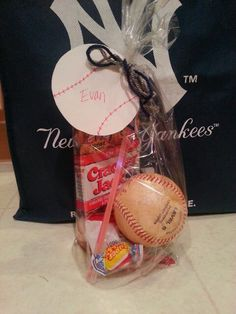 End of season gifts from Manager/Coach to kids... game baseball, Cracker Jacks, bubble gum, pack of baseball cards, glow sticks & fruit snacks. Add a baseball tag with kids name and yarn with team colors.