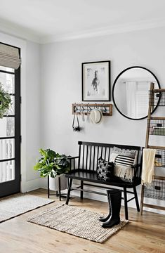 Refresh your entryway with a gorgeous indoor bench, a round mirror and other neutral pieces that add texture and depth! Save this pin for entryway inspiration!