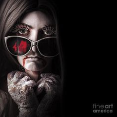 Horror fashion model wearing bloody sunglasses with gothic lace gloves and white face makeup. Vampire beauty in the darkness by Ryan Jorgensen