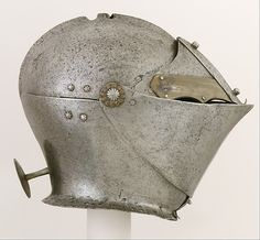 Armet Date: ca. 1490, with later additions Geography: Milan Culture: Italian, Milan Medium: Steel, brass Dimensions: H. 10 1/4 in. (26.04 cm); Wt. 6 lb. 7 oz. (2903 g) Classification: Helmets Credit Line: Gift of George D. Pratt, 1928 Accession Number: 28.74.2