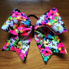 Bright Neon Floral Cheer Bow!  by CarleysBows on Etsy https://www.etsy.com/listing/216436635/bright-neon-floral-cheer-bow