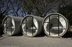 """Australia,Ottensheim """"Das Park Hotel"""" Rooms are converted water-pipe concrete ducts.There you will find one comfortable bed,place for keeping custody and lamp on the bedside table."""