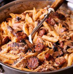 Creamy Cajun Shrimp Pasta with Sausage - What's In The Pan? Cajun Chicken And Sausage Pasta Recipe, Italian Chicken Pasta, Garlic Chicken, Chicken Penne, Creamy Cajun Chicken Pasta, Andouille Sausage Recipes, Cajun Sausage, Recipe Chicken, Tasty Chicken Pasta Recipes