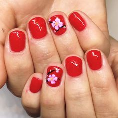 Cherry blossoms on cherry red #cherryblossoms #floralnailart #instanails #nailsoftheday #handpainted