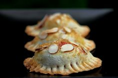 Raspberry, Goat Cheese & Almond Empanadas -   Ingredients:  15-18 medium or 25-30 small sweet empanada discs made from basic sweet pastry dough  12 oz raspberries  11 oz plain goat cheese, room temperature  ½ cup sugar  1 tsp vanilla  1 tbs orange zest  ½ cup sliced almonds  1 egg, yolk and white separated and lightly whisked  ¼ cup demerara sugar to sprinkle on top