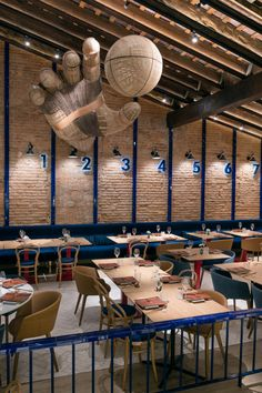 Mercader de Indias Creates a Spirited Restaurant for a Valencian Pilota Court