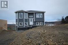 29 ERICA Avenue  Conception Bay South Newfoundland (1123400) | CONSTRUCTION STARTED IN SECOND PHASE OF MOUNT BATTEN ESTATES. COZY 2 BEDROOM OPEN CONCEPT SPLIT ENTRY WITH BAY WINDOW. GREAT STREET APPEAL. LANDSCAPED FRONT. DOUBLE PAVED DRIVEWAY. OCEAN VIEW. 7 YEAR HOME OWNERS WARRANTY.  For more info contact Wally Lane (709) 764-3363 wally@normanlane.ca