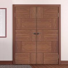The Ravenna walnut door pair has a distinctive modern groove design on a cross directional decorative walnut veneer. #walnutdoors #doubledoors