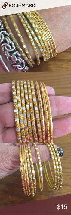 "Gold metal  bracelet bundle These are beautiful gold metal bracelets, two styles that are perfect together. They make that wonderful jingle when you wear them, wear them on their own or layer. I've got a bunch of bracelet bundles to list.  They measure 2.5"" in diameter. Pre loved but in beautiful condition.  This bundle is 9 bracelets. Jewelry Bracelets"