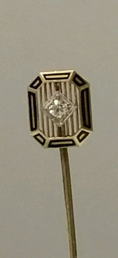"Up for sale is this beautiful 14K yellow gold black enamel diamond solitaire stick pin.  Weighs approx 2.05 grams  Measures approx 19.7 mm wide x 21.9 mm tall.  Entire pin measures approx 2.5"" tall  Professionally tested up to 14K 