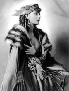 Greta Garbo. Ensemble by Adrian. Hmmmm.. Scarlett's dress from curtains in GWTW might have used this as inspiration?