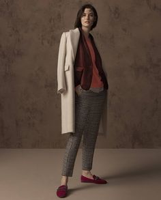 Autograph coat, £119, M&S Collection jacket, £69, M&S Collection jumper, £12.50, M&S Collection top, £15, M&S Collection trousers, £45, shoes, £29.50.