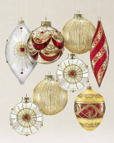 Each ornament is carefully hand-painted in rich burgundy and gold hues and adorned with faux crystals, beading, and glitter for added sparkle.