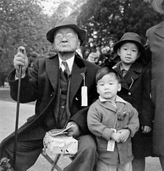Dorothea Lange, A grandfather and his grandchildren awaiting an evacuation bus in Hayward, California, May 1942; gelatin silver print; courtesy the Bancroft Library, U.C. Berkeley