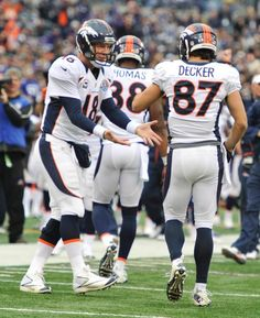 QB Peyton Manning gives WR Eric Decker a high-five for his efforts. Broncos vs. Ravens 12-16-2012.
