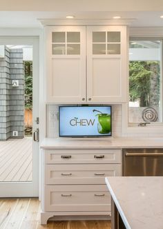 Check out this ingenious way to hide your TV in your kitchen!!