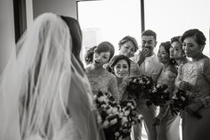 Amazed bridesmaids when seeing beautiful bride coming out after getting ready. If they are not amazed, come back in and we try again. Photo by Twenty One Studio.